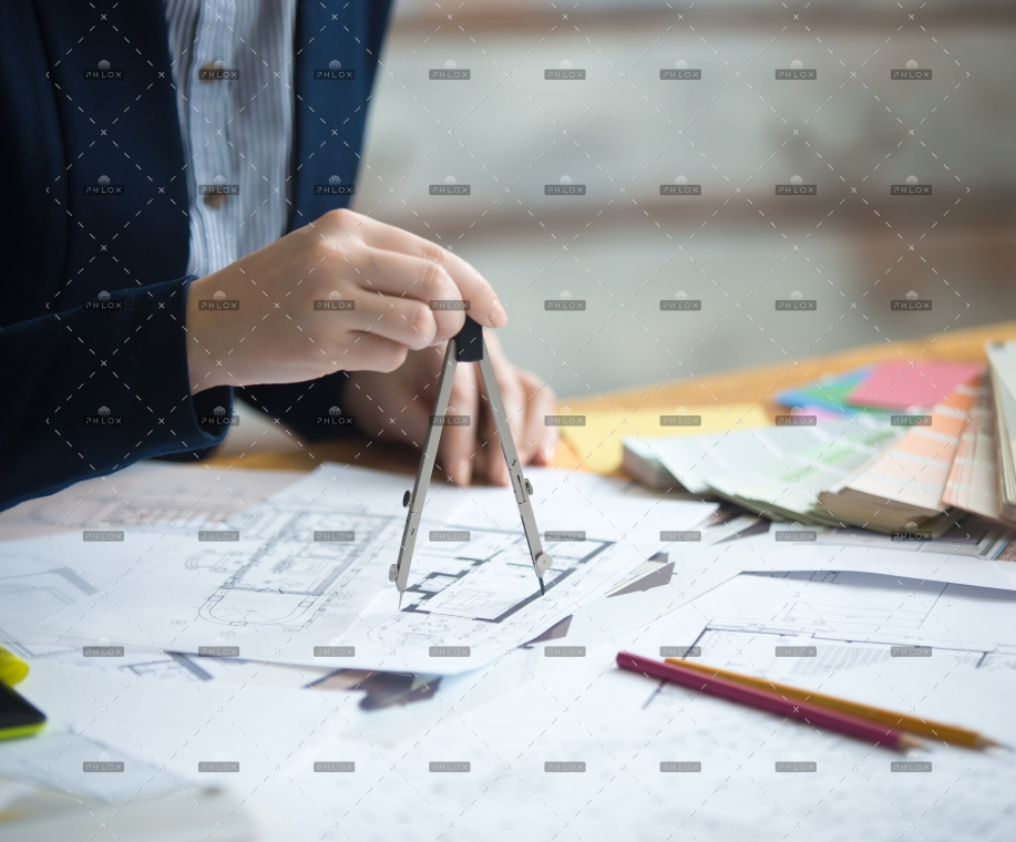 female-architect-using-drawing-compass-PZNMCEU-min